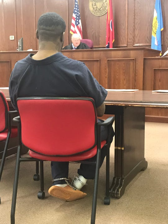 Justin Graves, 27, bounces his shackled feet as he sits at the defense table during his preliminary hearing for nine drug and driving-related charges in Jackson City Court on Dec. 12, 2019.