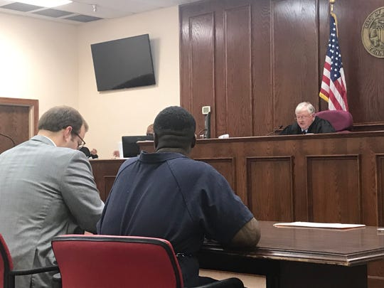 Justin Graves, 27, right, looks toward his attorney Mitchell Raines as Jackson City Court Judge Blake Anderson reads the charges against Graves during his preliminary hearing on Dec. 12, 2019.