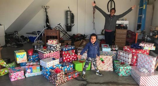 Christmas presents for Susannah's House. Neven and Mateya are learning to give back, too. 2017.