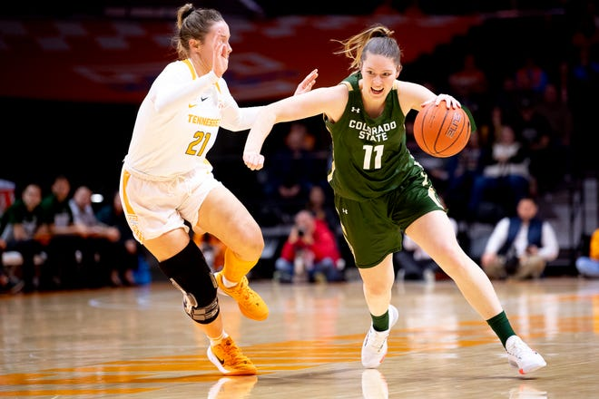 Colorado State forward Makenzie Ellis (11) dribbles the ball as Tennessee forward Lou Brown (21) defends during a game between Tennessee and Colorado State at Thompson-Boling Arena in Knoxville, Tenn. on Wednesday, Dec. 11, 2019.