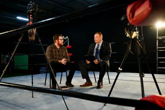 News Sentinel Urban Life writer Ryan Wilusz and Knox County mayor Glenn Jacobs at the Jacobs-Prichard Wrestling Academy on Monday, December 2, 2019.