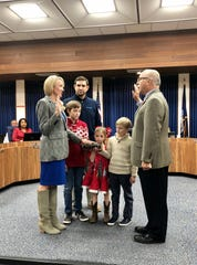 Clerk of Court Louis Perret swears in Hannah Smith Mason as District 8 representative of the Lafayette Parish School Board on Wednesday, Dec. 11, 2019. Husband Marcus Mason and their three children join her for the ceremony.