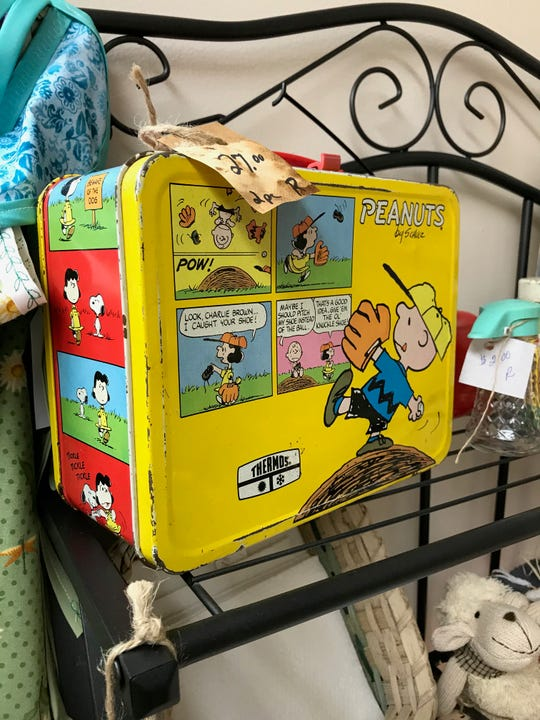"""This """"Peanuts"""" lunch box is one of the unique items for sale at G's Hidden Treasures."""