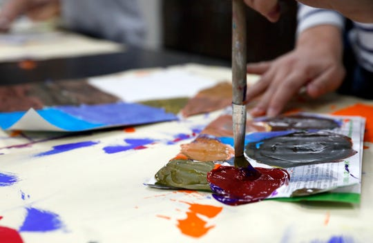 Sophia Bailey mixes different colors of paint to create a new shade as she works on an art project designed to teach third grade students fractions by having them mix different colors of paint together to create new shades Thursday, Dec. 12, 2019, at Mount Pleasant Elementary.