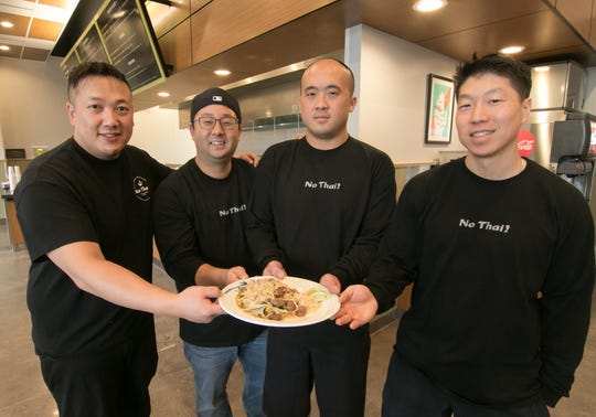 "From left, Noerung ""No"" Hang, Jeffery Cho, Steve Yang and Brian Kim hold one of their popular menu items, beef Pad Thai, inside Brighton's No Thai! restaurant on Thursday, Dec. 12, 2019, the day before it opened."