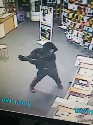 Surveillance video of a robbery at the Brighton Sprint store Wednesday Dec. 11, 2019.