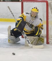 Hartland goalie Ryan Piros makes one of his 24 saves in a 4-2 victory over Howell on Wednesday, Dec. 11, 2019.