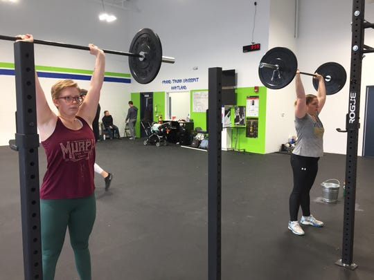 Heidi Blake, left, and Alisa Harwell work out at Grand Trunk CrossFit's new second location in the Hartland Sports Center, Thursday, Dec. 12, 2019.