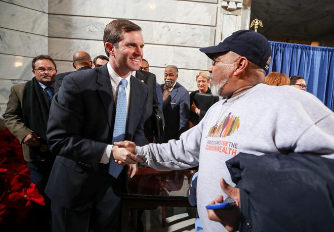"""Juan Gomez shakes the hand of Gov. Andy Beshear after the Governor signed an executive order to restore the voting rights of around 140,000 non-violent felons. Gomez was convicted of burglary 15 years ago and served two years. """"I believe in the law,"""" Gov. Andy Beshear said. """"I also believe in second chances."""" Dec. 12, 2019"""