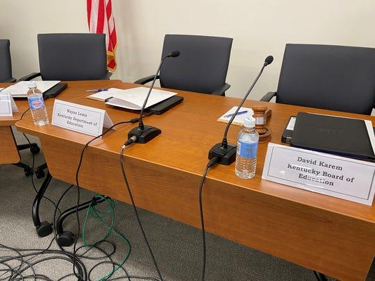 Wayne Lewis' seat at the board meeting