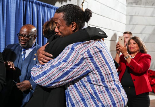 """Rynn Young gets a hug after his voting rights were restored Thursday after Gov. Andy Beshear signed an executive order to restoring voting rights for non-violent felons.  """"Today is a day I thought I'd never see,"""" Young of Louisville said. He was convicted of drug possession when he was 18."""