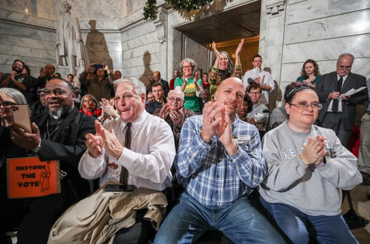 Visitors in the capitol rotunda clap, cheer and whistle as Gov. Andy Beshear talks about giving non-violent felons the right to vote again before he signed an executive order to do just that Thursday afternoon in Frankfort. Dec. 12, 2019