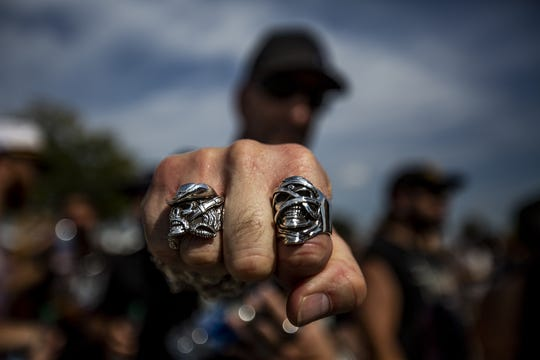 James Grodeski from Houston, Texas, shows off his rings at the Louder Than Life Music Festival in Louisville, Kentucky. Sept. 28, 2019.