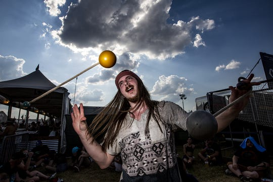 Cory Landfather, of Missouri, practiced some movement art at the Louder Than Life Music Festival in Louisville Kentucky. Sept. 29, 2019.