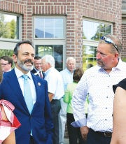 Then-Gov. Matt Bevin with Eric Baker, right, during a 2018 fundraiser at the Baker home in Corbin, Kentucky.