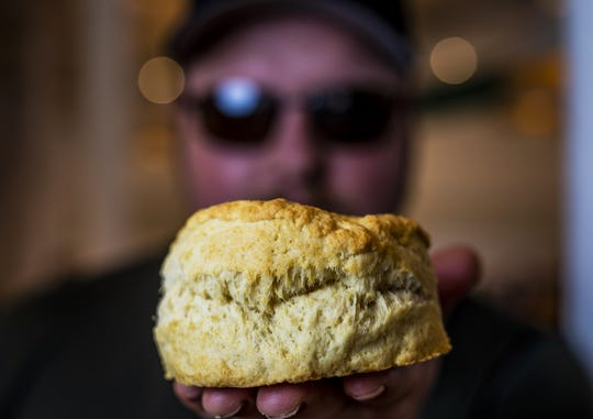 Chef Tavis Rockwell at Biscuit Belly held up one of his giant biscuit creations. June 5, 2019