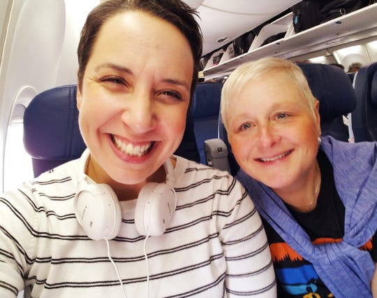 """Lansing resident Robin Miner-Swartz and her wife Betsy on a plane headed to Los Angeles, where Miner-Swartz competed in an episode of """"Jeopardy!"""" scheduled to air later this month."""