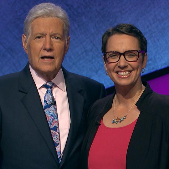 "Lansing resident Robin Miner-Swartz with ""Jeopardy!"" host Alex Trebek."