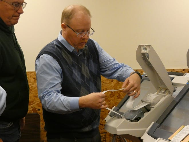 An employee of voting system vendor Dominion re-prints the paper ballots from some electronic voting machines used on Election Day 2018. The re-printed ballots were counted as part of a recount of the 2018 county prosecutor's race. The ballots needed to be re-printed because some of the ones printed on Election Day 2018  were illegible.