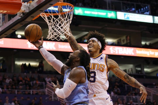 Phoenix Suns forward Kelly Oubre Jr., right, goes in for a blocked shot against Memphis Grizzlies forward Jae Crowder, left, during the first half on Wednesday, Dec. 11, 2019 in Phoenix.