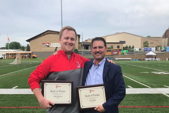 The Oconomowoc community has raised more than $30,000 for lacrosse coach Erin Ennis (right), who is battling stage 4 colon cancer. He's seen here with Jake Sweitzer, the boys varsity head coach at Arrowhead.
