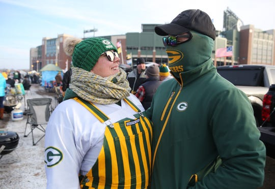 Jasmine, left, and Derek Bennett, from East Troy, are bundled up from the cold before the Green Bay Packers  game against the Washington Redskins Dec. 8 at Lambeau Field. The forecast high for Sunday's playoff game against the Seattle Seahawks is 25 degrees.