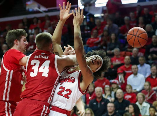Wisconsin guard Brad Davison collides with Rutgers guard Caleb McConnell as they battle under the basket Wednesday night.