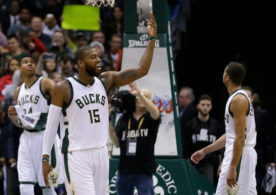 Milwaukee Bucks' Greg Monroe (15) pumps up the crowd during the second half of Milwaukee's game against the Golden State Warriors on Dec. 12, 2015. The Bucks ended the Warriors' 24-game winning streak with a victory.