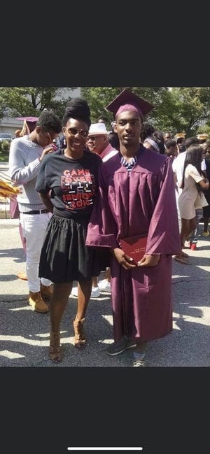 Camille Mays celebrates her son, Darnell Woodard II, at his graduation from Vincent High School.