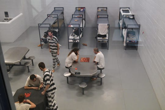 Inmates in the Marion County jail play games and rest in one of the jail's pods recently. Officials have reached a compromise for the 2020 budget to operate the jail and the sheriff's office.