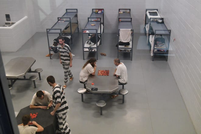 Inmates in the Marion County jail play games and rest in one of the jail's pods. Marion County Sheriff Clinton Evans has started housing state prisoners in a formerly unused pod of the jail. The move brings in state revenue to the county for each prisoner the county holds for the state.
