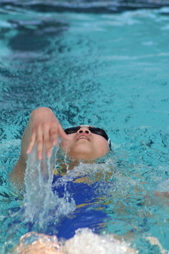 Mountain Home's Julia Nguyen competes in a backstroke event during recent action at Batesville. The Bombers and Lady Bombers competed at Pocahontas on Tuesday.