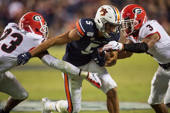 Auburn wide receiver Anthony Schwartz (5) runs the ball after a catch at Jordan-Hare Stadium in Auburn, Ala., on Saturday, Nov. 16, 2019. Georgia defeated Auburn 21-14.