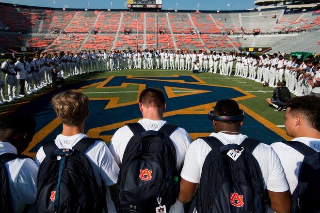 Auburn players gather for a prayer before taking on Tulane at Jordan-Hare Stadium in Auburn, Ala., on Saturday, Sept. 7, 2019.