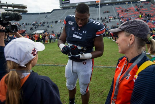 Auburn defensive lineman Derrick Brown (5) signs autographs after the game at Jordan-Hare Stadium in Auburn, Ala., on Saturday, Nov. 23, 2019. Auburn defeated Samford 52-0.