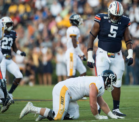 Auburn defensive lineman Derrick Brown (5) reacts after knocking the ball down at the line at Jordan-Hare Stadium in Auburn, Ala., on Saturday, Sept. 14, 2019. Auburn defeated Kent State 55-16.