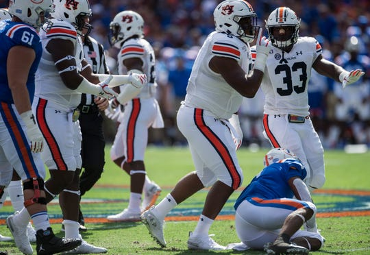 Auburn defensive lineman Derrick Brown (5) silences the crowd with a stop in the backfield at Ben Hill Griffin Stadium in Gainesville, Fla., on Saturday, Oct. 5, 2019.