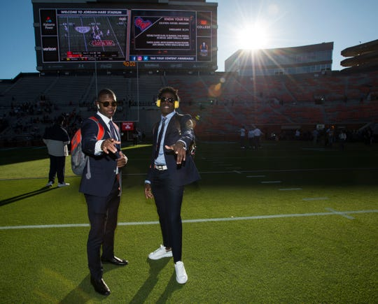 Auburn defensive backs Zion Puckett (11) and Smoke Monday (21) pose for a picture at Jordan-Hare Stadium in Auburn, Ala., on Saturday, Nov. 2, 2019.