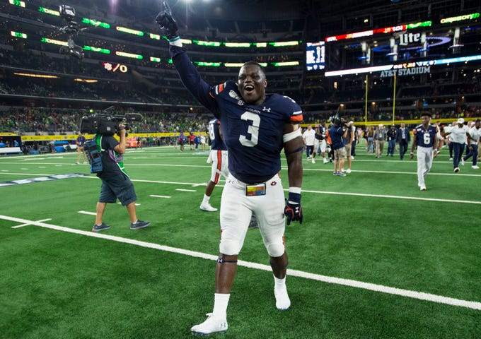 Auburn defensive lineman Marlon Davidson (3) celebrates after the game at AT&T Stadium in Arlington, Texas, on Saturday, Aug. 31, 2019. Auburn defeated Oregon 27-21.