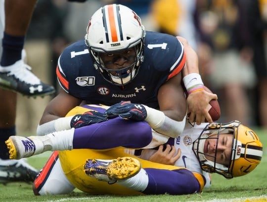 Auburn defensive lineman Big Kat Bryant (1) jumps on LSU quarterback Joe Burrow (9) for a sack at Tiger Stadium in Baton Rouge, La., on Saturday, Oct. 26, 2019. LSU defeated Auburn 23-20.