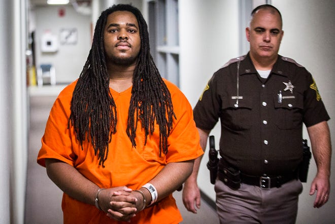 Daveon Hendricks is escorted to Circuit Court 1 in the Delaware County Justice Center for sentencing Thursday, Dec. 12, 2019. Hendricks was convicted in October of murder and conspiracy to commit robbery. The hearing was postponed, and held on Feb. 24, 2020