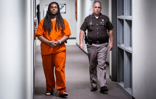 Daveon Hendricks is escorted to Circuit Court 1 in the Delaware County Justice Center for a hearing on Thursday, Dec. 12, 2019. Hendricks was convicted in October of murder and conspiracy to commit robbery.