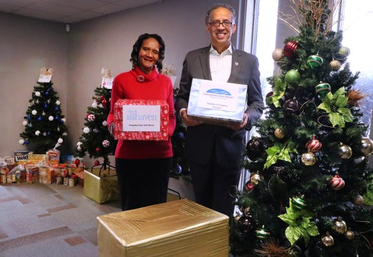 The Rev. Donna Morgan and the Rev.  Vincent Windrow stand with some of the 12 giving trees at Olive Branch Church on Dec. 12, 2019. Six trees are at the Murfreesboro church, and six are at the Antioch location. Each tree represents a nonprofit to which people can donate.