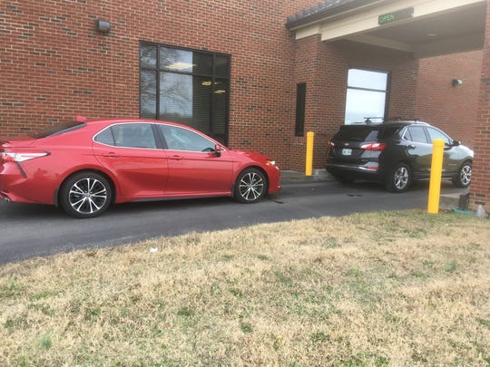 Rutherford County drivers use the drive-thru Thursday, Dec. 12, 2019, to pay the wheel tax and vehicle registration fee at the County Clerk's Smyrna office.