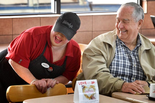 Ashley Adams laughs as she kids around with John Porter, one of the regulars at the Wendy's on West Main Street in Lebanon, on Dec. 12, 2019.