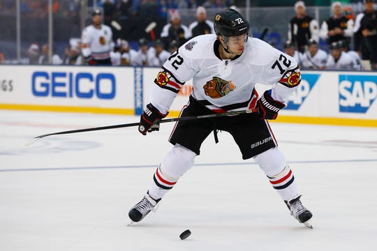 Chicago Blackhawks' Artemi Panarin, of Russia, gets ready to shoot the puck during the first period of the NHL Winter Classic hockey game against the St. Louis Blues at Busch Stadium, Monday, Jan. 2, 2017, in St. Louis. (AP Photo/Billy Hurst)