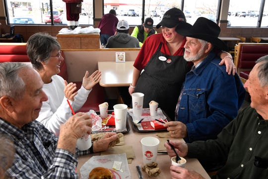 Ashley Adams is a ray of sunshine who freely gives hugs to regulars like Alton Driver as she makes her rounds and lights up the Wendy's on West Main Street in Lebanon on Dec. 12, 2019. Adams has worked at the fast-food restaurant for 10 years.