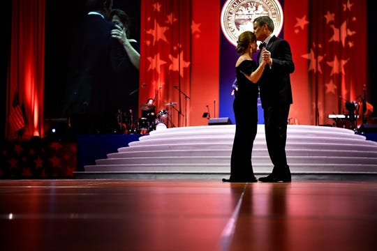 Gov. Bill Lee kisses his wife, Maria, as they dance during the First Couple's Inaugural Dinner and Ball in the Music City Center Grand Ballroom in downtown Nashville on Saturday, Jan. 19, 2019.