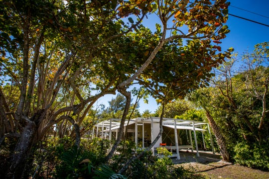 """The Walker guest home and main home on Sanibel. The guest home is nicknamed the """"spider"""" because of the beams that were built off the home to hold the weights for the shutters."""