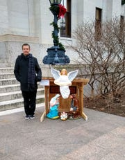 Rick Jones, of Newark, stands next to his nativity display at the Ohio Statehouse on Wednesday.